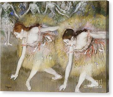 Dancers Bending Down Canvas Print by Edgar Degas