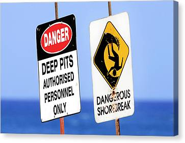 Dangerous Surf Warning Signs At Pipeline On Oahu's North Shore.  Canvas Print by Sean Davey