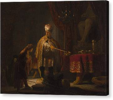 Daniel And Cyrus Before The Idol Bel Canvas Print by Rembrandt
