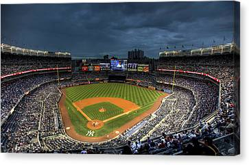 Dark Clouds Over Yankee Stadium  Canvas Print by Shawn Everhart