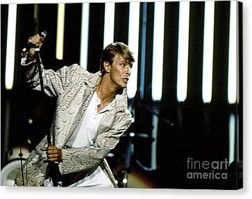 Canvas Print featuring the photograph David Bowie Action Man by Sue Halstenberg