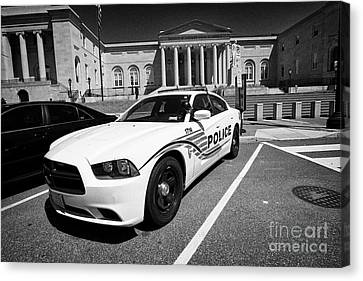 dc police car in front of District of Columbia City Hall now the court of appeals judiciary square W Canvas Print by Joe Fox