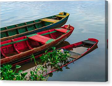 Decaying Boats Canvas Print by Celso Bressan