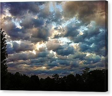 Deceptive Clouds Canvas Print by Cricket Hackmann