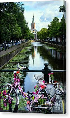 Canvas Print featuring the photograph Canal And Decorated Bike In The Hague by RicardMN Photography