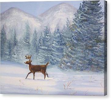 Deer In The Snow Canvas Print by Denise Fulmer