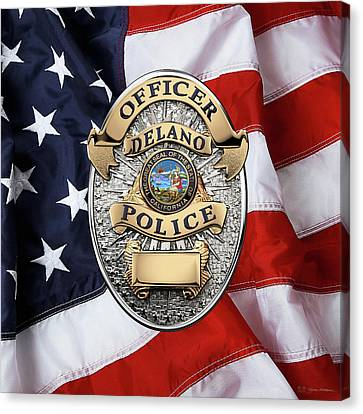 Delano Police Department - Officer Badge Over American Flag Canvas Print by Serge Averbukh