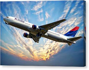 Delta Passenger Plane Canvas Print by Anthony Dezenzio