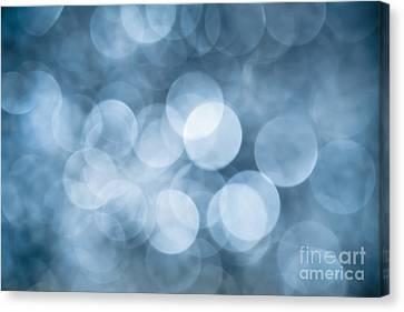 Canvas Print featuring the photograph Denim Blue Bokeh by Jan Bickerton