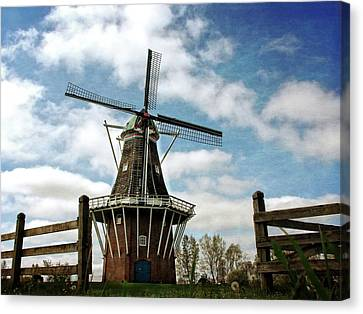 Canvas Print featuring the photograph Dezwaan Windmill With Fence And Clouds by Michelle Calkins