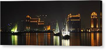 Dhows In West Bay Doha Canvas Print by Paul Cowan