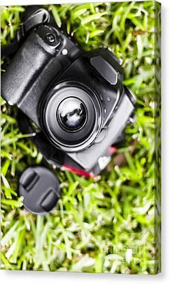 Digital Slr Camera On Green Grassy Field Canvas Print by Jorgo Photography - Wall Art Gallery