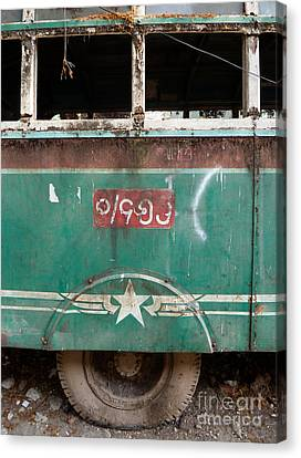 Dilapidated Vintage Green Bus In Burma - Side View With Tire Canvas Print