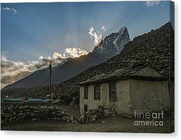 Canvas Print featuring the photograph Dingboche Nepal Sunrays by Mike Reid