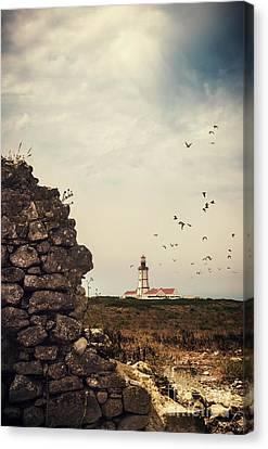 Distant Lighthouse Canvas Print