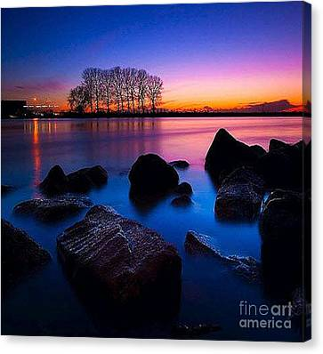 Distant Shores At Night Canvas Print by Rod Jellison