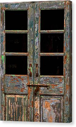 Distressed Doors Canvas Print by Juli Ellen