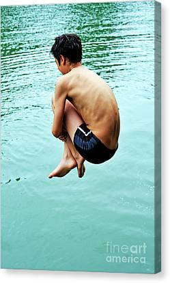 Diving Into Water Canvas Print by Sami Sarkis