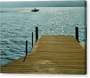 Dock And Speedboat Canvas Print by Steven Ainsworth