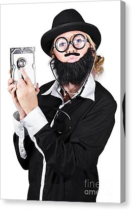 Doctor Examining Hard Drive Canvas Print by Jorgo Photography - Wall Art Gallery