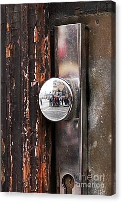 Door Reflections Canvas Print by John Rizzuto