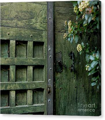Door With Padlock Canvas Print by Bernard Jaubert