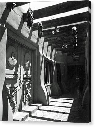 Doors And Shadows Canvas Print by Allan McConnell