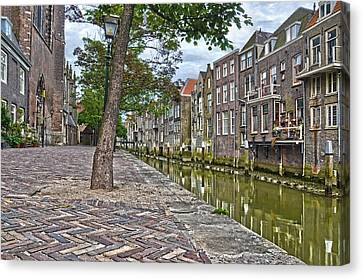 Canvas Print featuring the photograph Dordrecht Behind The Church by Frans Blok