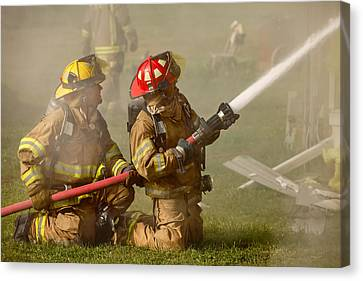 Dousing The Flames Canvas Print by Todd Klassy