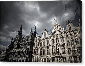 Drama At Grand Place Canvas Print by Chris Fletcher