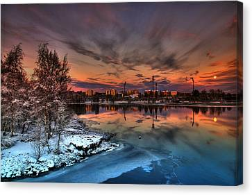 Dramatic Moonrise In Sunset Light In Winter In Finland Canvas Print by Sandra Rugina