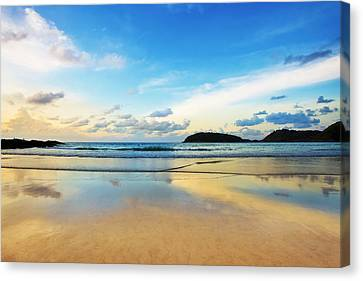 Dramatic Scene Of Sunset On The Beach Canvas Print by Setsiri Silapasuwanchai