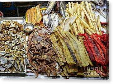 Canvas Print featuring the photograph Dried Fish Is Sold At The Market by Yali Shi