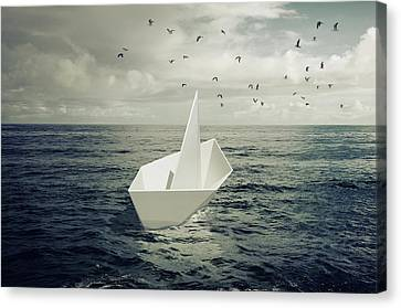 Drifting Paper Boat Canvas Print by Carlos Caetano