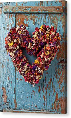 Peeling Canvas Print - Dry Flower Wreath On Blue Door by Garry Gay