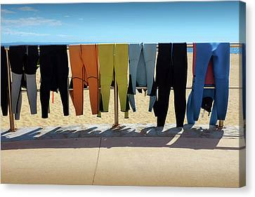 Drying Wet Suits Canvas Print by Carlos Caetano