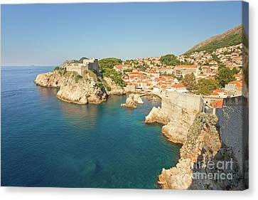Dubrovnik City Walls And Inviting Adriatic Canvas Print by Matt Tilghman