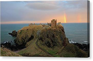 Canvas Print featuring the photograph Dunnottar Castle Sunset Rainbow by Grant Glendinning