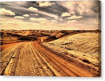 Dusty Dakota Road Canvas Print by Jeff Swan