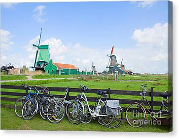 dutch windmills with bikes in Zaanse Schans Canvas Print by Anastasy Yarmolovich