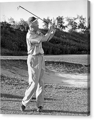 Dwight Eisenhower Golfing Canvas Print by Underwood Archives