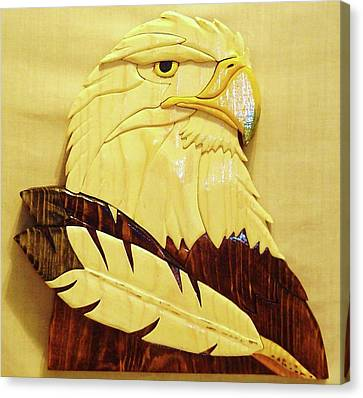 Eaglehead With Two Feathers Canvas Print by Russell Ellingsworth