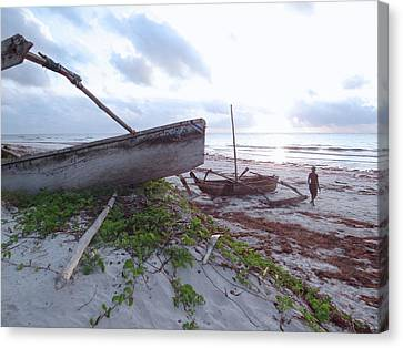 early morning African fisherman and wooden dhows Canvas Print