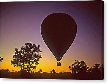 Canvas Print featuring the photograph Early Morning Balloon Ride by Gary Wonning