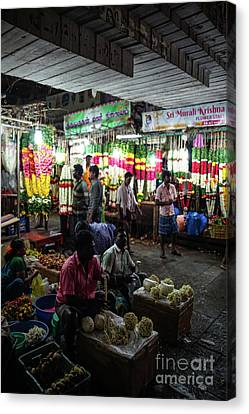 Canvas Print featuring the photograph Early Morning Koyambedu Flower Market India by Mike Reid