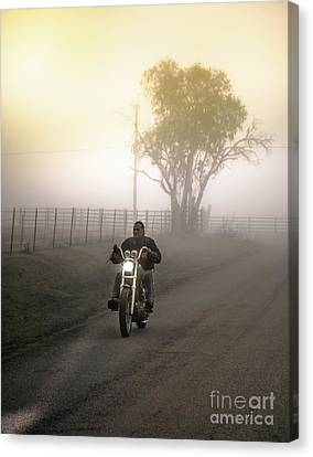 Early Rider In Fog Canvas Print by Robert Frederick