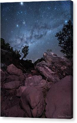 Earth Among The Stars Canvas Print by Santiago Rolon
