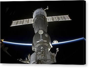Earths Limb Intersects A Soyuz Canvas Print by Stocktrek Images