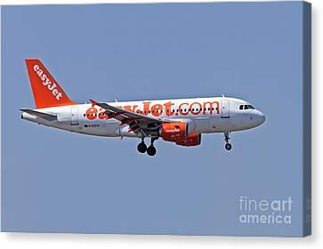 Easyjet Airbus A319 At Milan Canvas Print by Amos Dor
