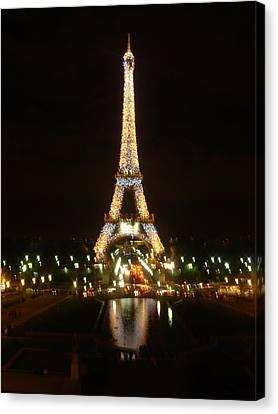 Eiffel Tower At Night Canvas Print by John Julio